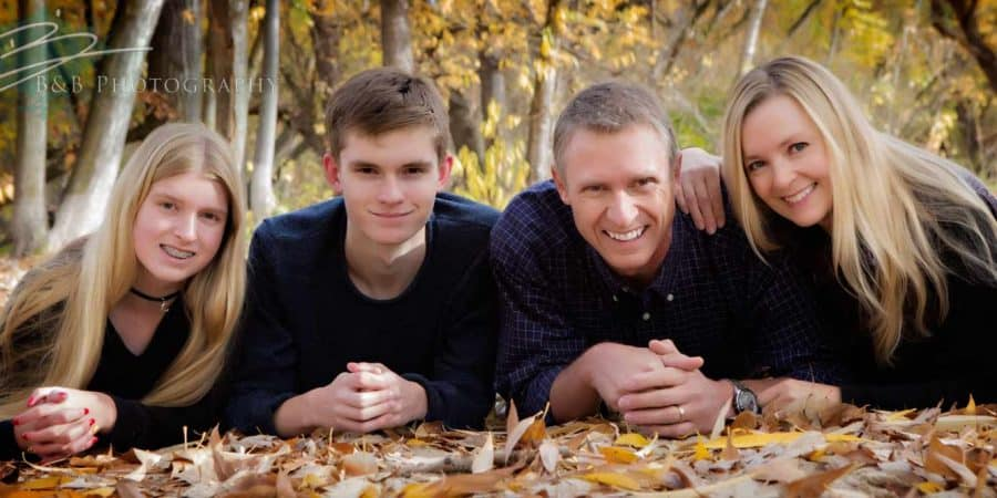 A fall time photo of a family in Kathryn Albertson Park