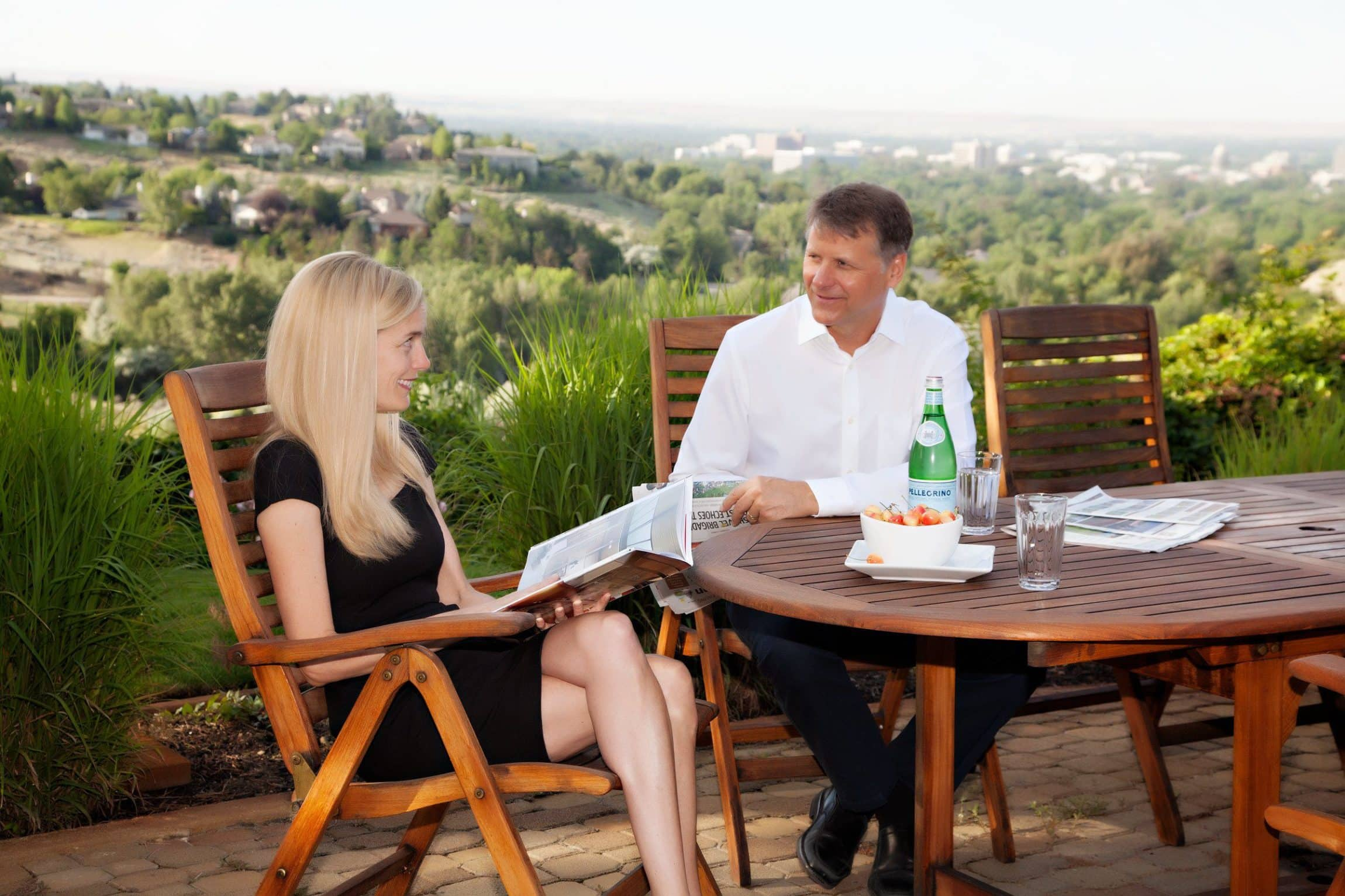 Man and woman sitting at outdoor table