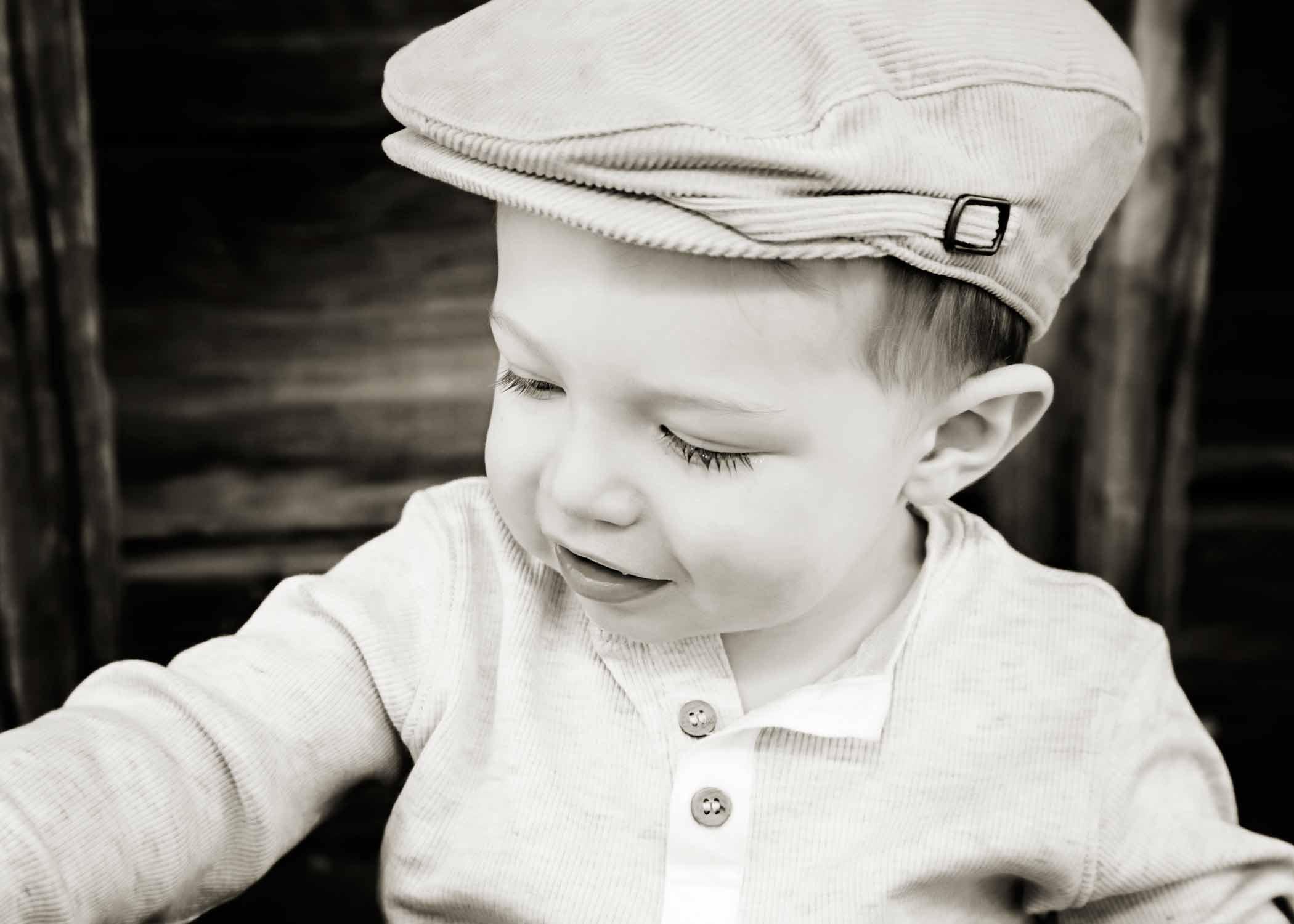 Child wearing a flat cap