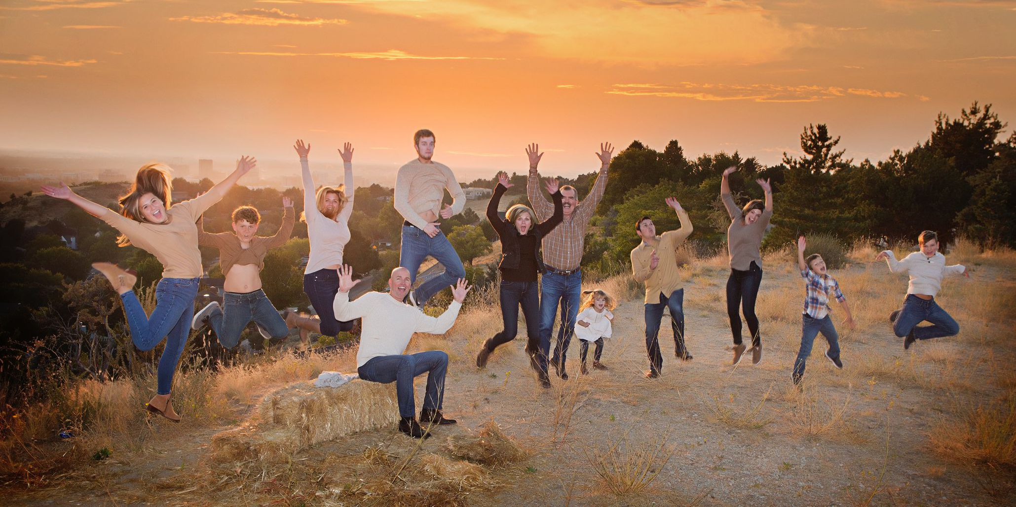 Family jumping on hill top