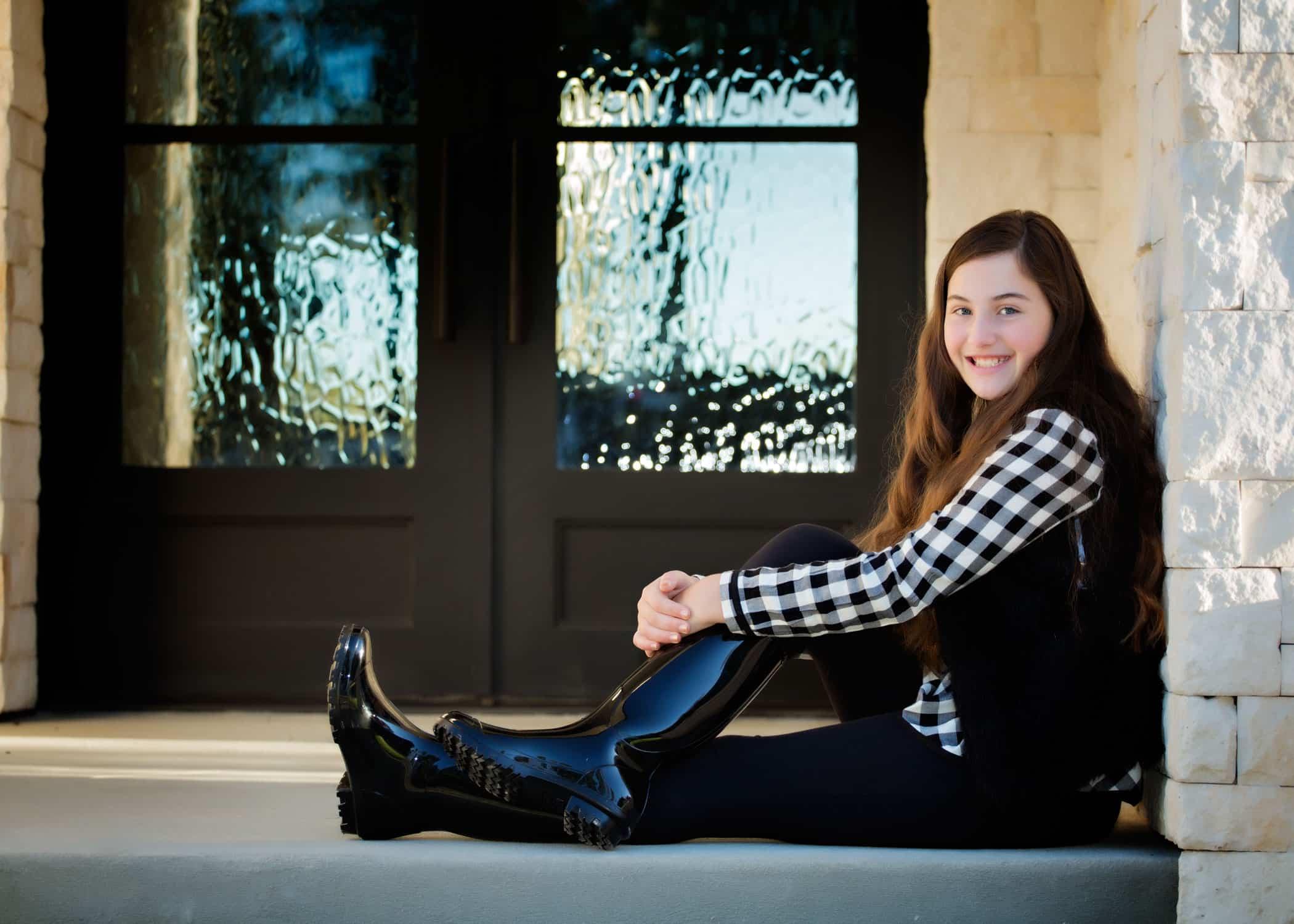Child sitting in a doorway