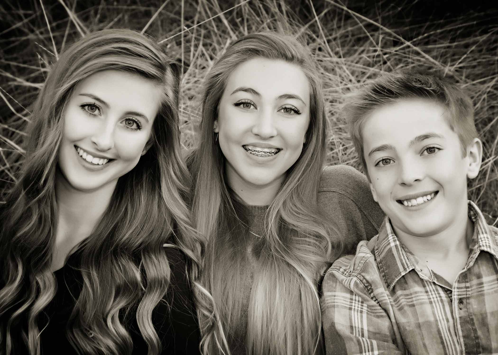 Three children in a black and white portrait by Boise B&B Photography