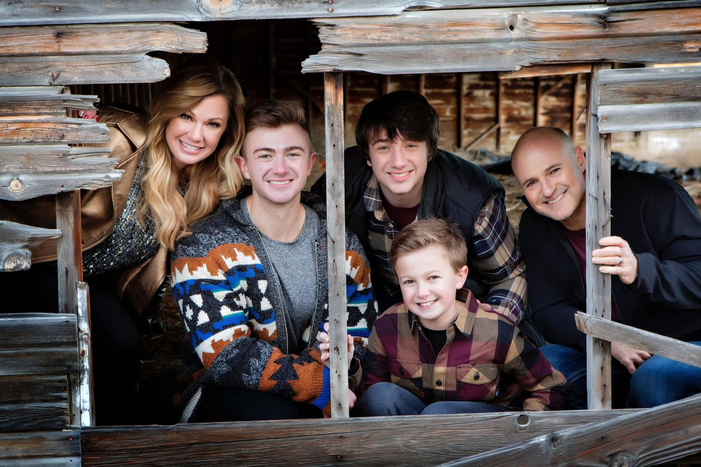 Casual family picture in a barn.