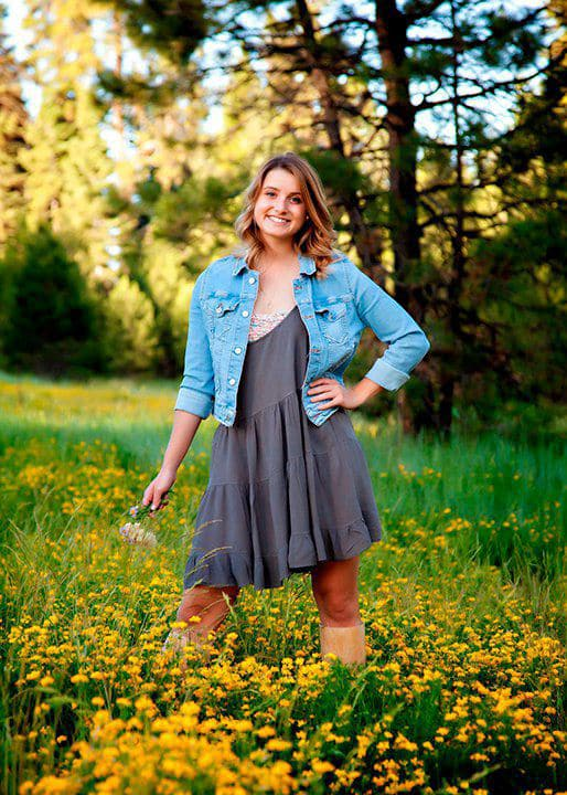 Young lady in flowering meadow in McCall Idaho