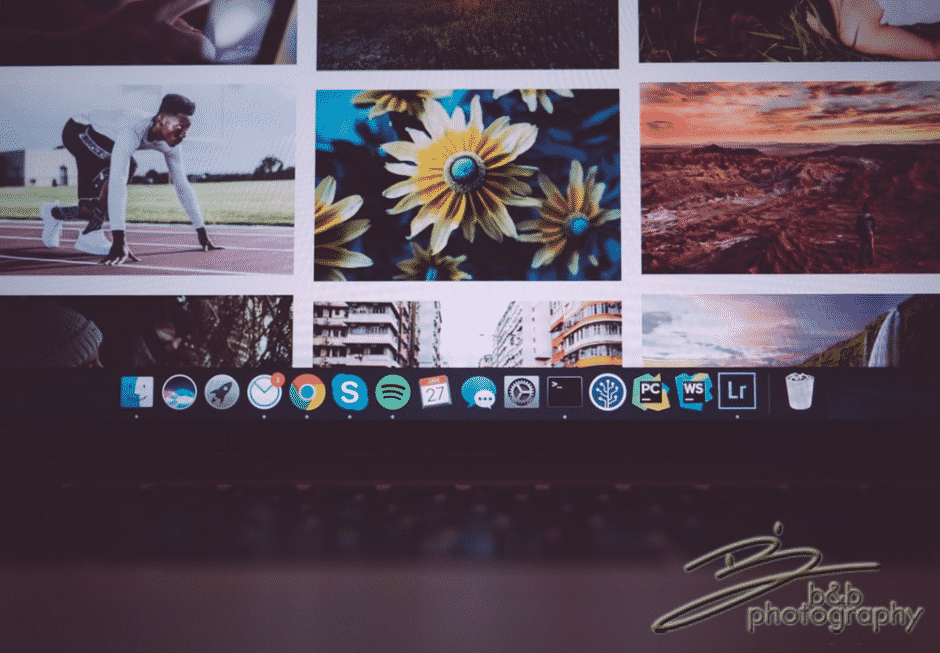 A desktop monitor displaying photos