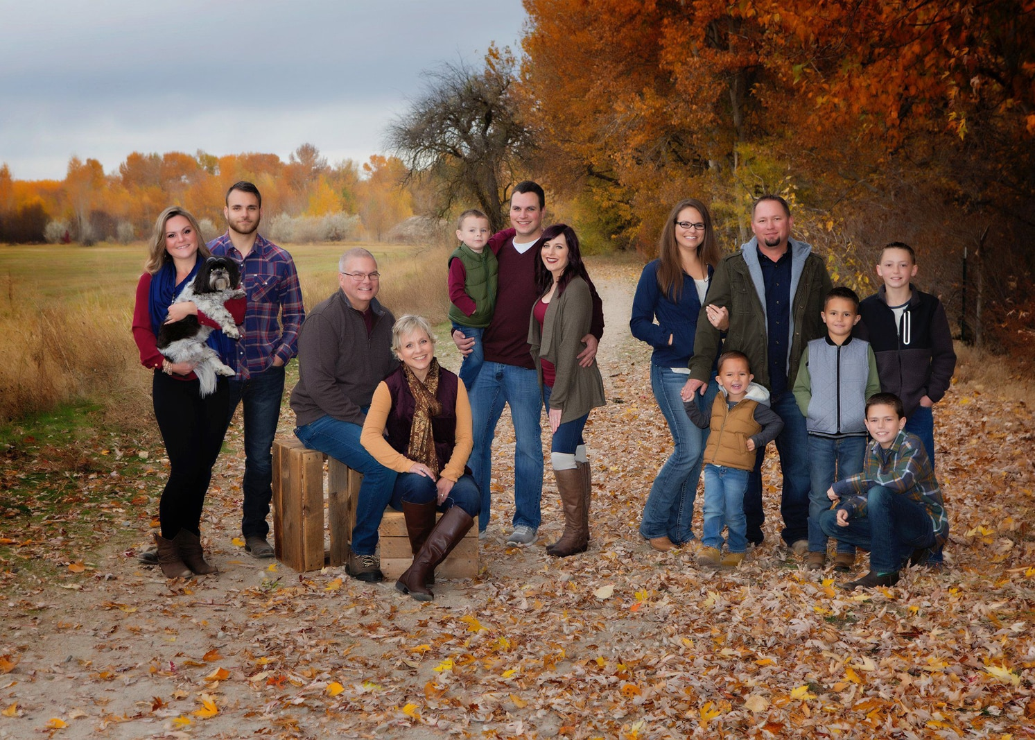 Family together at the edge of woods