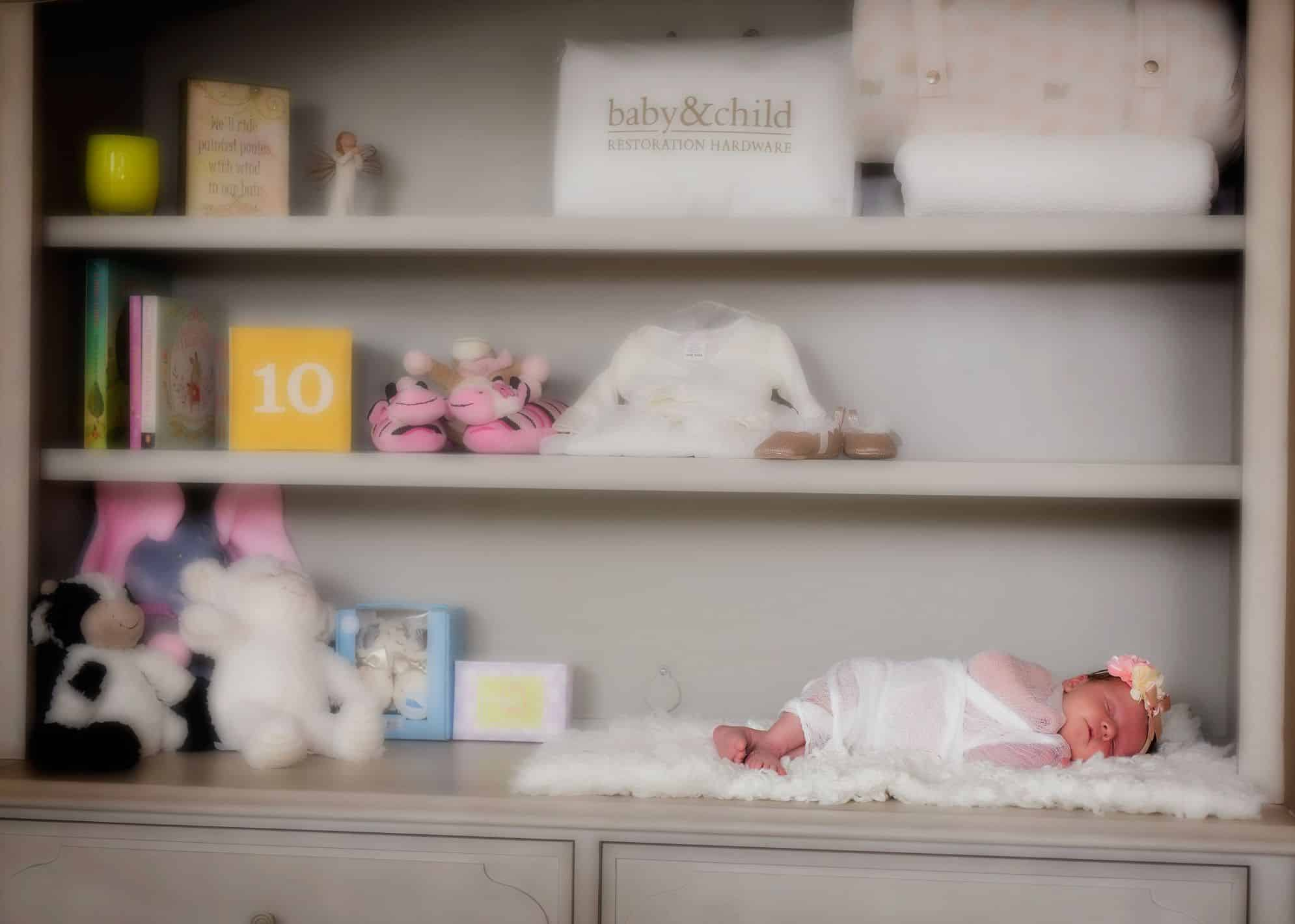 baby on a bookshelf