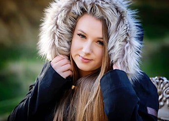 Woman with a fur hood on