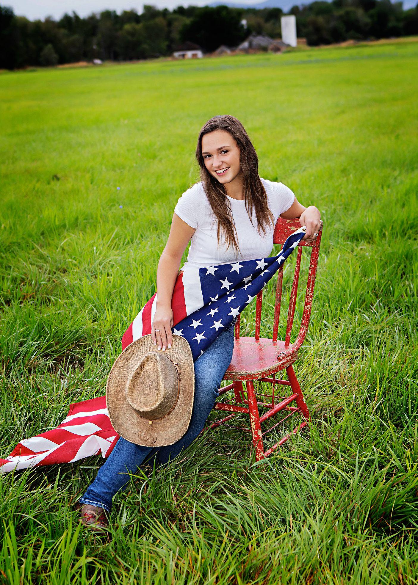 high school senior girl with flag