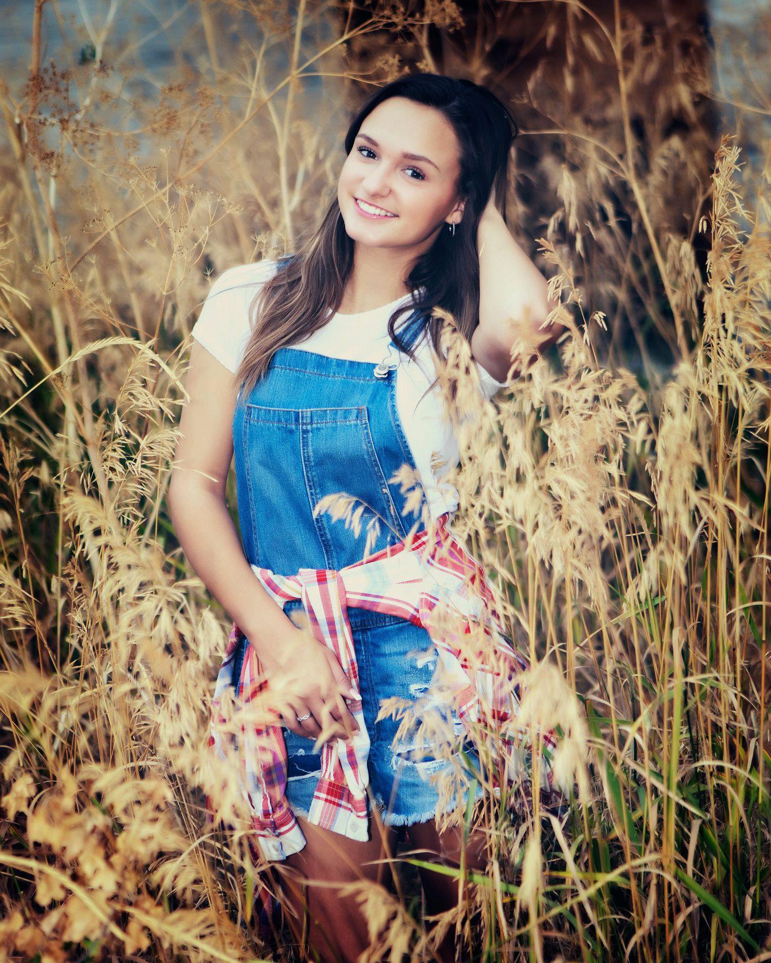 Woman standing in wild grass field